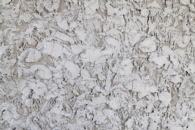 El cemento texturiza la pared gris cubierta con yeso áspero imagen de archivo libre de regalías