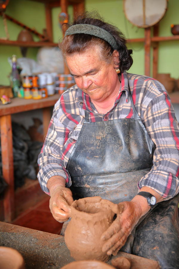 EL CERCADO, LA GOMERA, SPAIN - MARCH 23, 2017: portrait of a woman making a traditional clay pot. El Cercado is famous for its cer. Portrait of a woman making a stock images