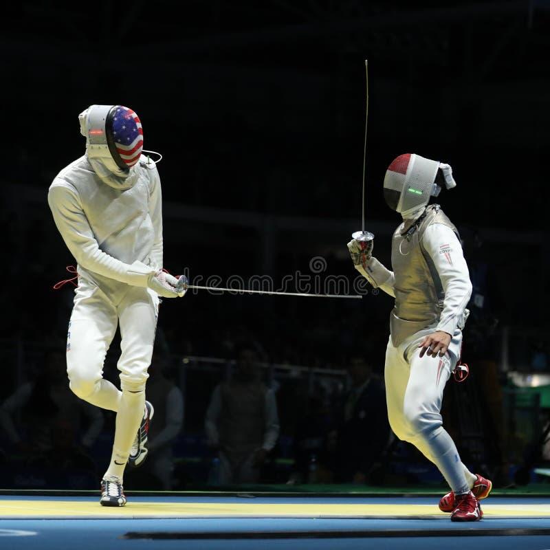 El cercador del equipo L de Estados Unidos compite contra el cercador de Egipto del equipo en la hoja del equipo del ` s de los h fotos de archivo