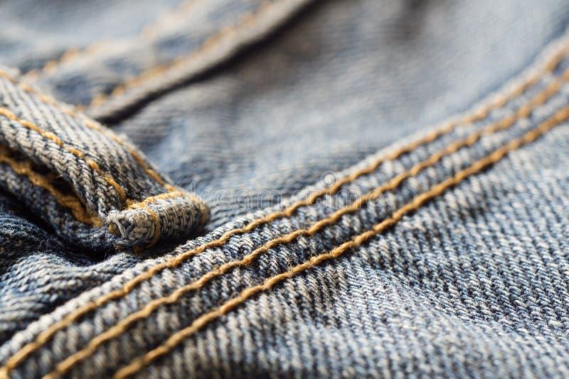 El cierre encima del tiro macro de los tejanos del dril de algodón texturiza el fondo, sele imagen de archivo libre de regalías