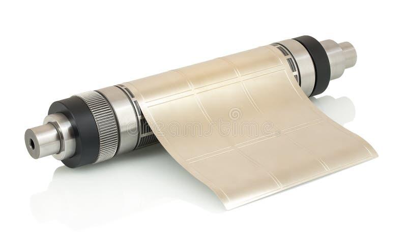 El cilindro magnético con flexible atado muere por cortar con tintas en la máquina flexográfica de la prensa usada para la fabric foto de archivo libre de regalías