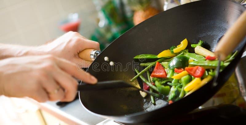 El cocinar del cocinero imagen de archivo