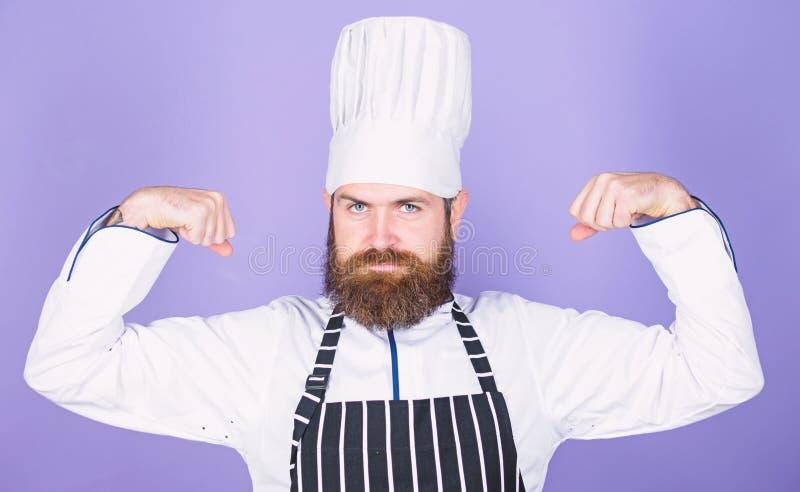 El cocinar es mi poder Cocinar el empleo f?cil y agradable Cocinero convertido en el restaurante Cocinero profesional confidente fotos de archivo libres de regalías