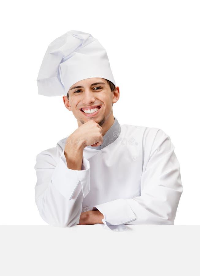 El cocinero del cocinero apoya la cabeza con la mano fotos de archivo libres de regalías