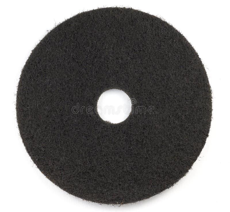 El cojín negro del piso friega la piel de ante fotografía de archivo