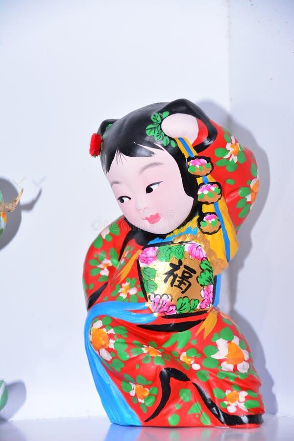 El color de la escultura de arcilla de la niña foto de archivo