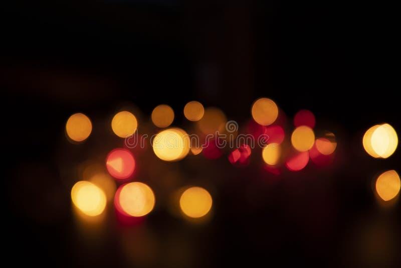 El color de la luz destella anaranjado bajo la forma de Bokeh imágenes de archivo libres de regalías