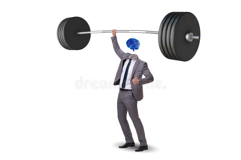 El concepto con el hombre y la pesa de gimnasia del cerebro imagen de archivo libre de regalías
