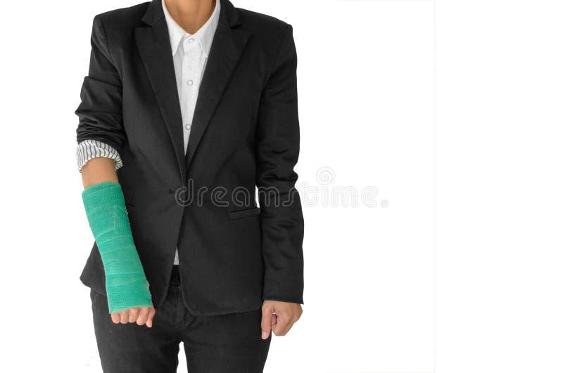 El concepto de lesión del cuerpo, empresaria herida con verde echó en la ha imágenes de archivo libres de regalías