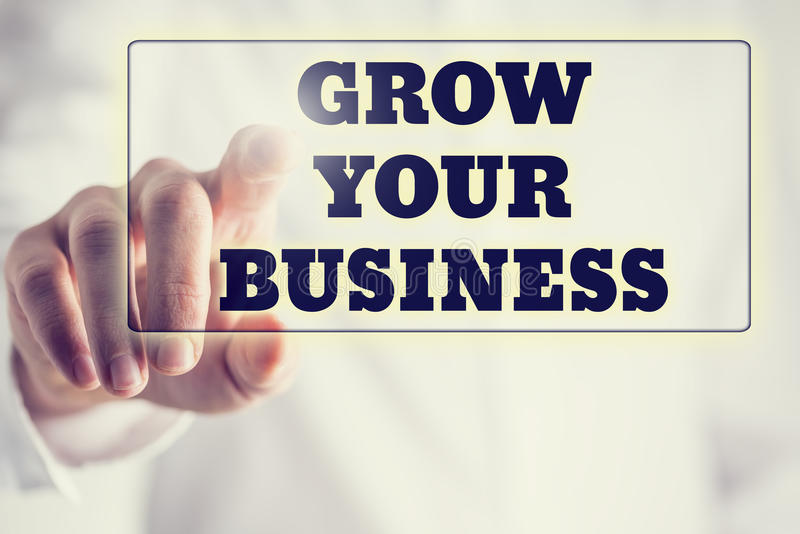 El concepto de nuevo o crea el negocio - palabras crecer su negocio o foto de archivo