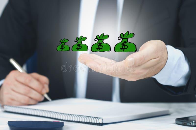 El concepto de riqueza y de dinero foto de archivo libre de regalías