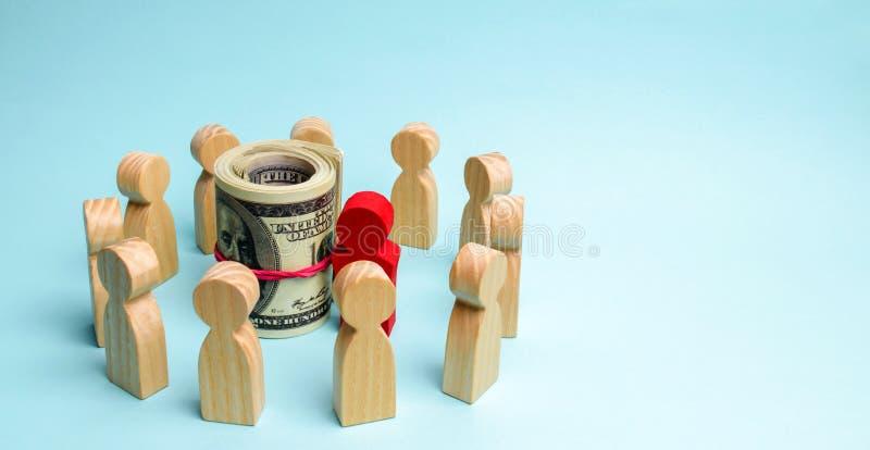 El concepto de un líder empresarial El jefe se coloca en el centro del equipo y da instrucciones y puntos a las metas y imágenes de archivo libres de regalías