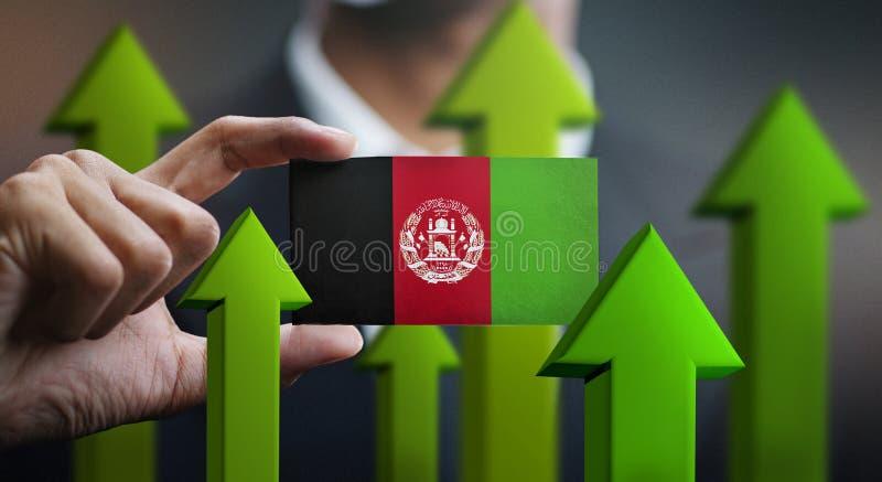 El concepto del crecimiento de la nación, se pone verde encima de las flechas - hombre de negocios Holding Car foto de archivo libre de regalías
