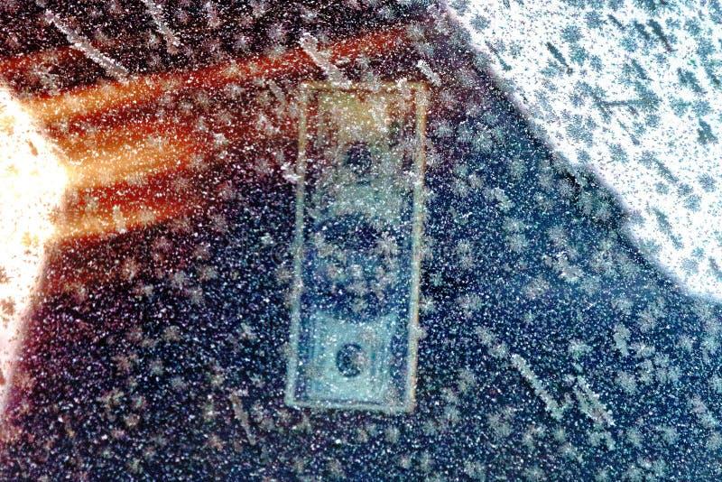 El concepto del dólar congelado en un punto, 100 dólares congeló fotos de archivo libres de regalías