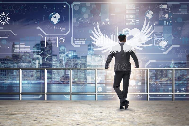 El concepto del inversor del ángel con el hombre de negocios con las alas fotos de archivo libres de regalías