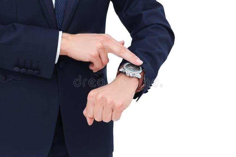 El concepto es ahorrar su tiempo hombre de negocios que señala en su wristw foto de archivo