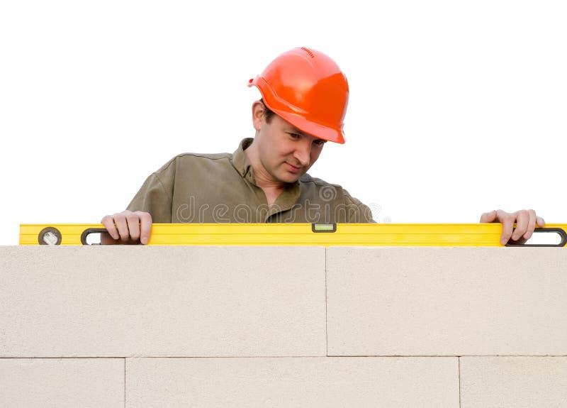 El constructor comprueba un nivel fotografía de archivo libre de regalías