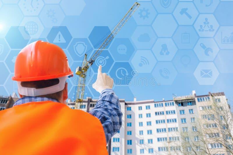 El constructor es edificio de funcionamiento la casa fotografía de archivo