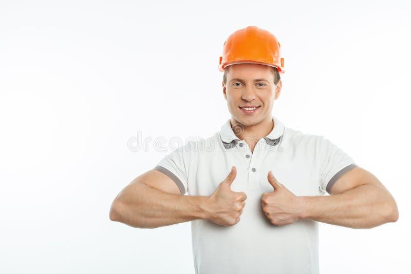 El constructor joven hermoso está expresando el positivo imagen de archivo