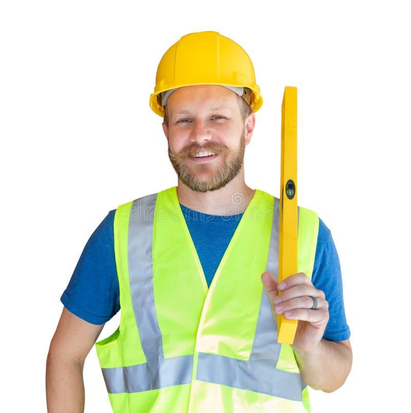 El contratista masculino caucásico con el chaleco del casco, del nivel y de la seguridad aisló fotos de archivo libres de regalías