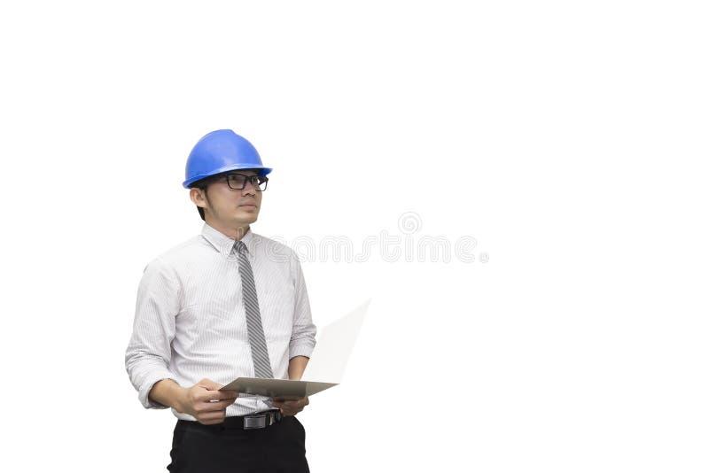El control del ingeniero de construcción el papel imagenes de archivo