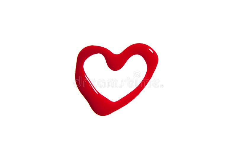 El corazón hizo de esmalte de uñas en rojo fotos de archivo