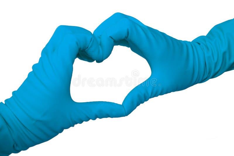 El corazón hizo por dos manos en guantes del látex en blanco fotos de archivo libres de regalías