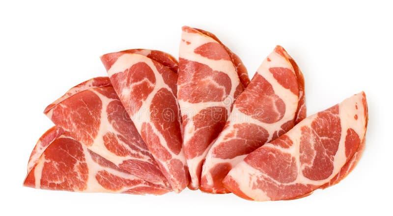 El cortar de la carne presentado en un blanco La forma del top fotografía de archivo