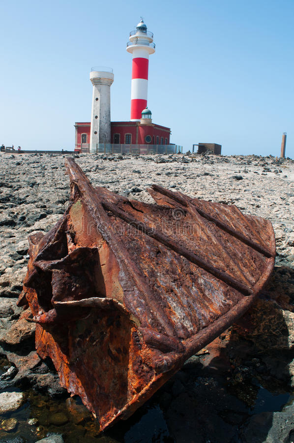 El Cotillo, Fuerteventura, Canary Islands, Spain, beach, Ocean, El Toston, lighthouse, relax, water, nature, landscape. The wreck of a ship and El Toston royalty free stock image