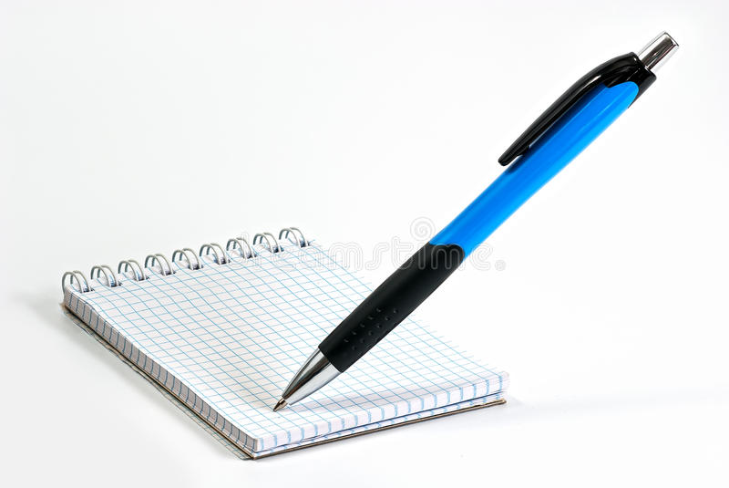El cuaderno con la escritura ballpen fotografía de archivo libre de regalías