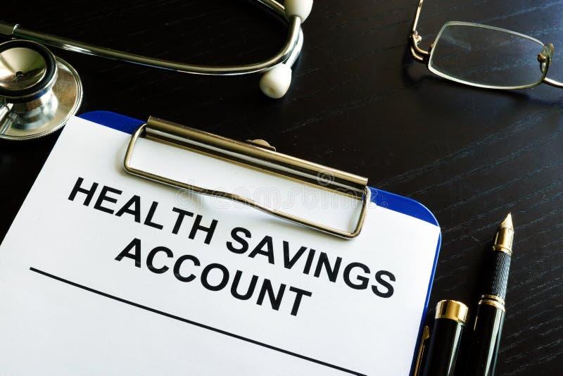 El cuenta de ahorros de la salud TIENE forma foto de archivo libre de regalías