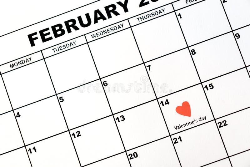 El día de tarjeta del día de San Valentín, el 14 de febrero, en el calendario imagen de archivo libre de regalías