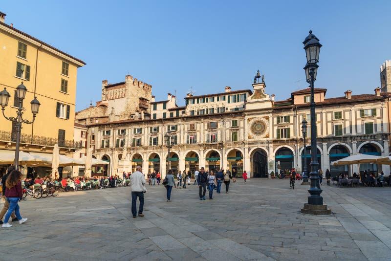El dell ?Orologio de Torre es torre de reloj en logia cuadrada del della de la plaza en Brescia Italia fotografía de archivo libre de regalías