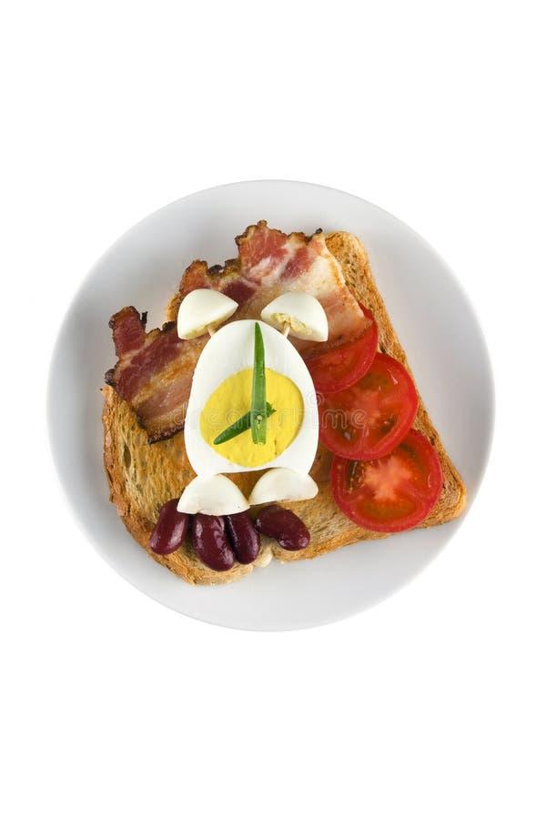 El desayuno inglés con el alarmar-huevo. imágenes de archivo libres de regalías