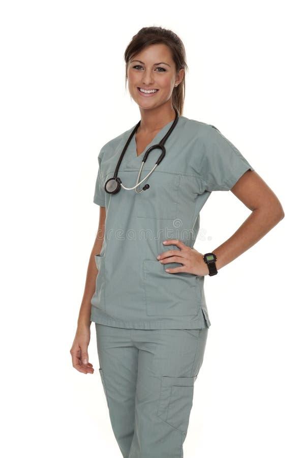 El desgastar bonito de la enfermera friega imagen de archivo libre de regalías
