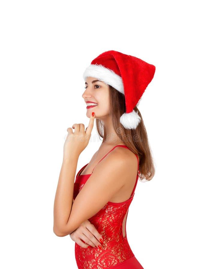 El desgaste modelo femenino hermoso en traje de baño y el sombrero de la Navidad llevan a cabo el pom del pom mujer emocional en  foto de archivo