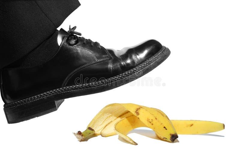 El deslizarse en la cáscara del plátano foto de archivo libre de regalías