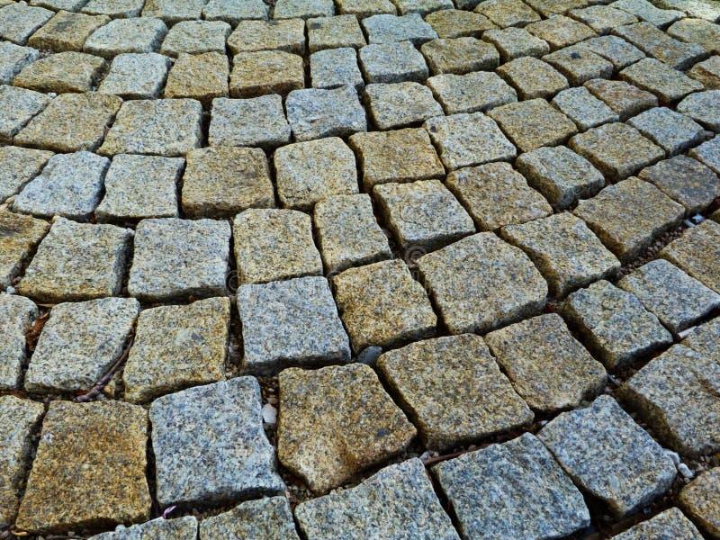 El detalle de piedra del pavimento del cuarzo texturizado y rústico del cubo de formas cuadradas fijó libremente imágenes de archivo libres de regalías