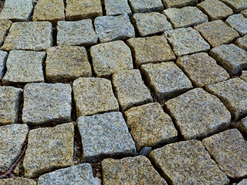 El detalle de piedra del pavimento del cuarzo texturizado y rústico del cubo de formas cuadradas fijó libremente foto de archivo