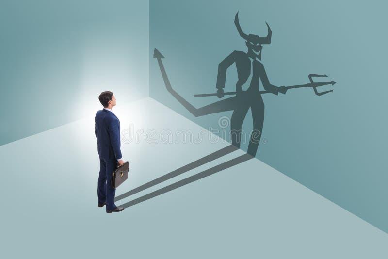 El diablo que oculta en el hombre de negocios - concepto del alter ego fotos de archivo libres de regalías