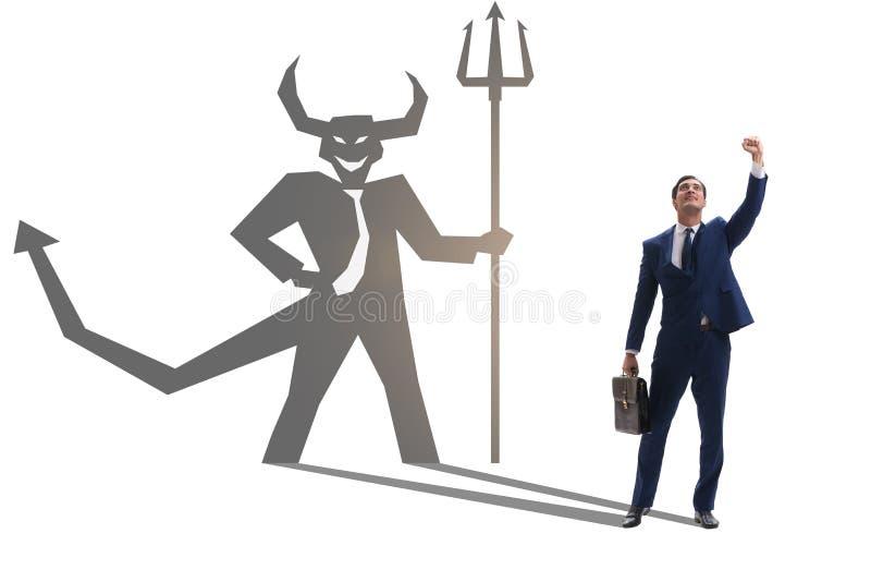El diablo que oculta en el hombre de negocios - concepto del alter ego imágenes de archivo libres de regalías