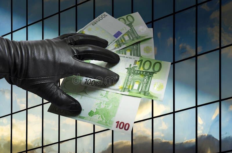 El dinero roba seguridad de las finanzas fotografía de archivo