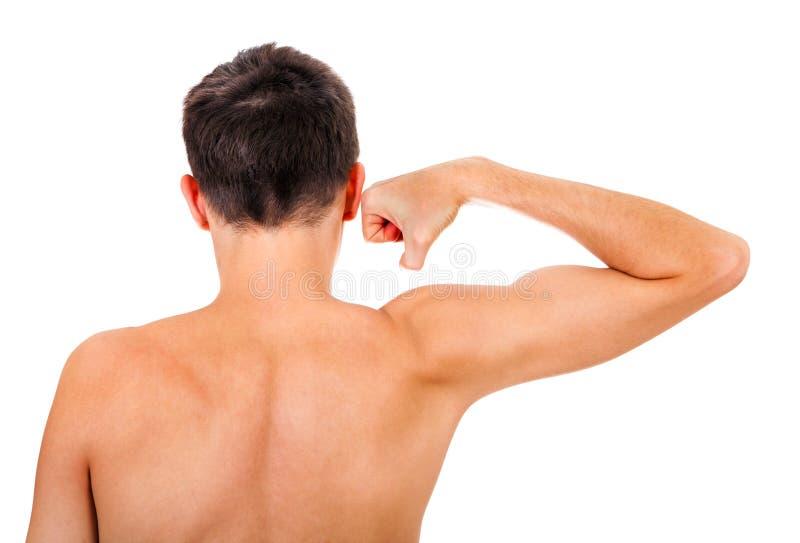 El doblar de músculo del hombre joven imagenes de archivo