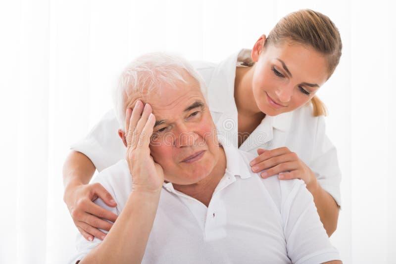 El doctor Consoling Male Patient foto de archivo