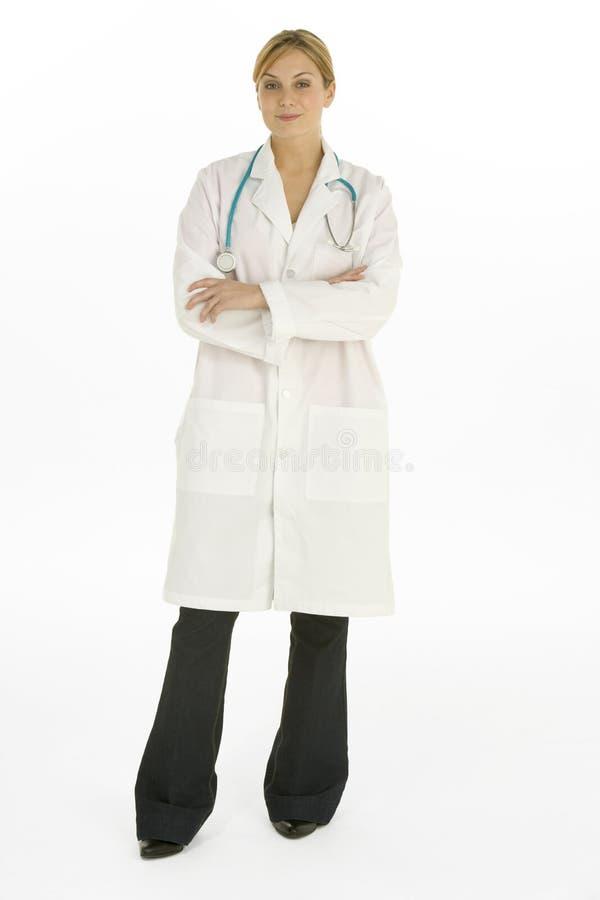 El doctor de sexo femenino Against White Background imagen de archivo libre de regalías