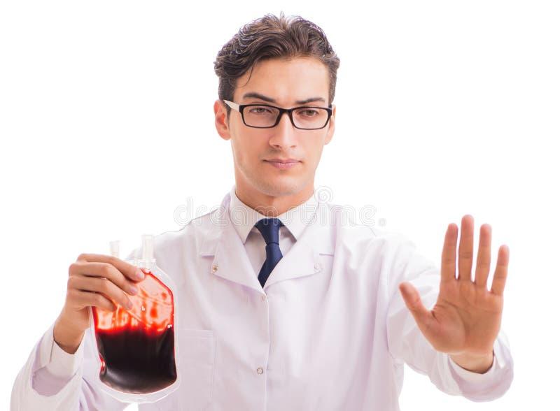 El doctor en concepto de la donaci?n de sangre aislado en blanco imagen de archivo libre de regalías