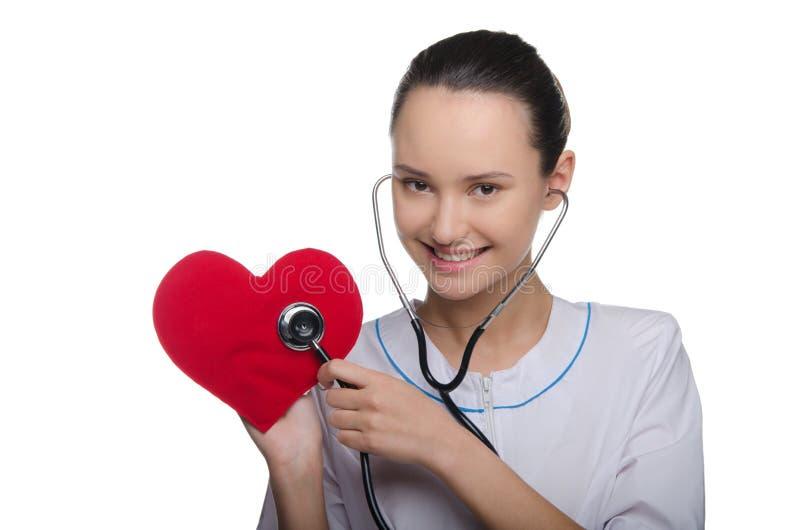 El doctor escucha el estetoscopio del corazón foto de archivo libre de regalías