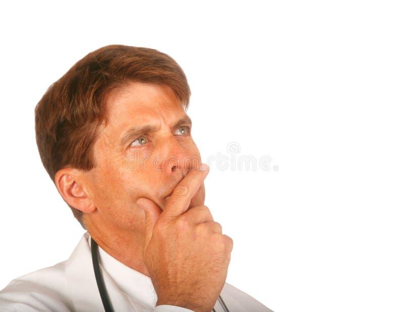 El doctor Pondering un problema foto de archivo
