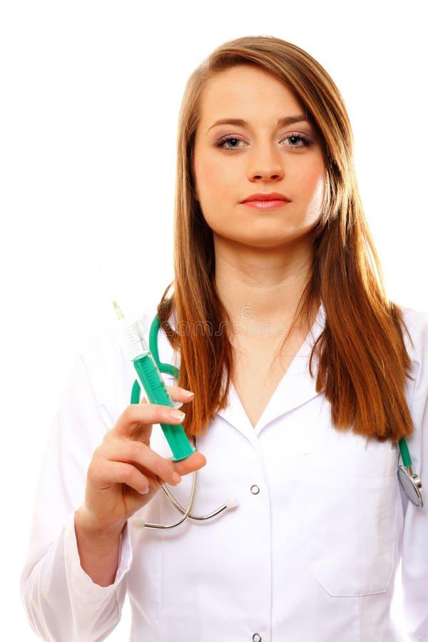 El doctor sostiene una jeringuilla, concepto de la atención sanitaria imagen de archivo