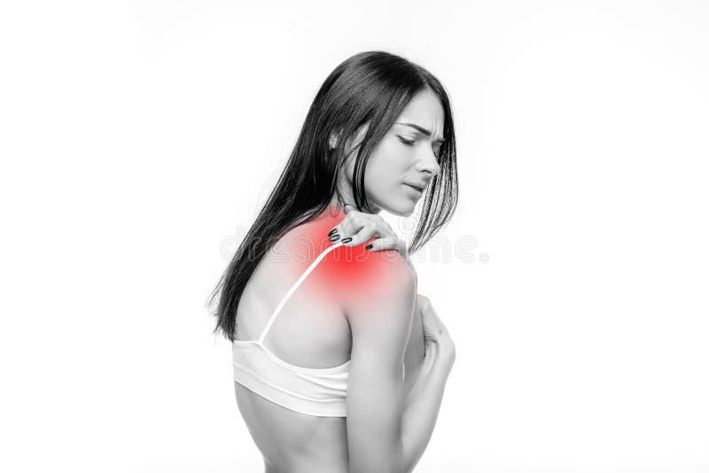 El dolor común, mujer tiene problema con el hombro imagen de archivo